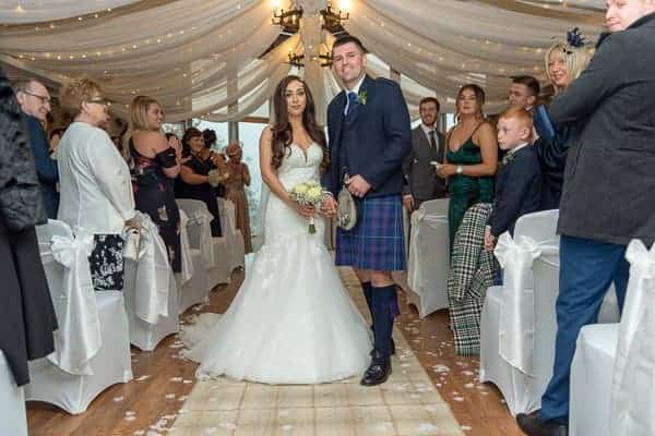 Wedding Photography Lodge on the lch loch lomond bride and groom returning up the aisle as husband and wife